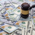 wooden gavel with usa money on desk for divorce lawyers Taylor
