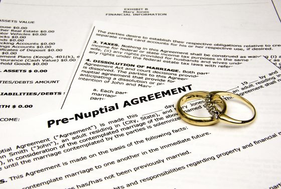 Pre-nuptial agreement with wedding bands for a prenuptial agreement attorney royal oak