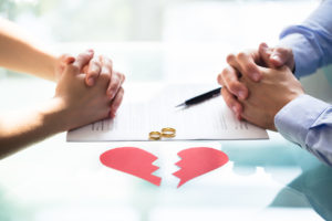 couple considering divorce and dividing marital assets with divorce lawyer in troy