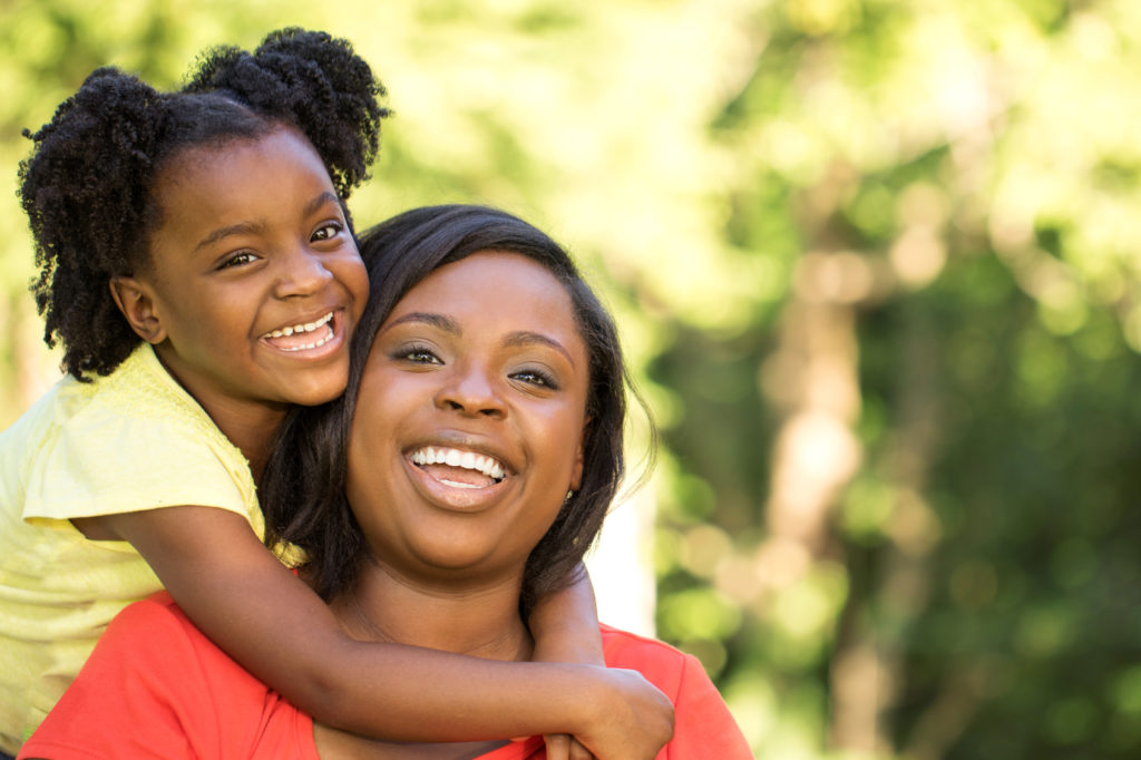 mother with her daughter happy from their parenting plan arranged with a good child custody lawyer in Birmingham